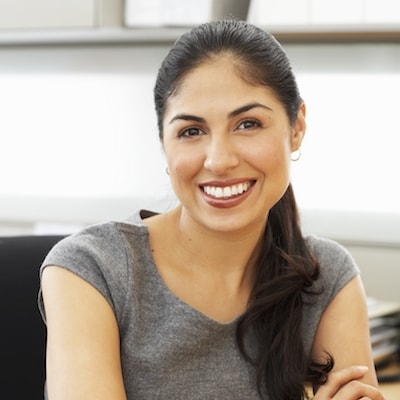 Business woman smiling after her restorative dentistry visit where she got dental crowns