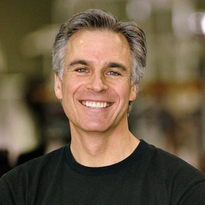 Older man smiling thanks to dental implants and Baton Rouge restorative dentistry