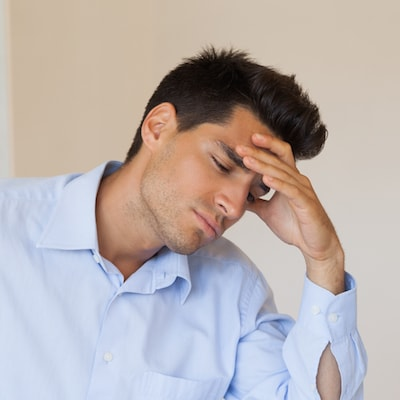 Man holding his head because he has a TMJ disorder and needs restorative dentistry in Baton Rouge