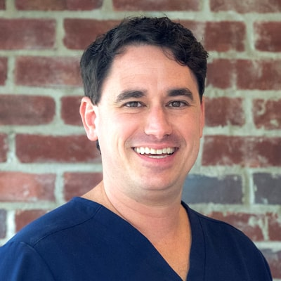 Dr. Dustin Kidder smiling as one of our caring and skilled dentists in Baton Rouge